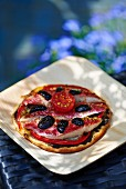 Pizza with red mullet, olives and tomatoes