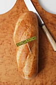 A loaf of organic bread with a label (seen from above)