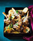 Braised lamb shanks with potatoes in a coconut sauce