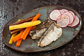 Sardines with carrots, olive oil and radishes