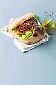 A grilled rump steak and salad sandwich