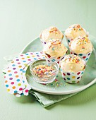 Cupcakes with butter cream and coloured sprinkles