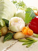 A carved kohlrabi rose, a carrot flower and various types of vegetables