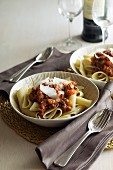 Pasta with a meat sauce and Parmesan cheese