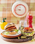 Two tuna and bean burgers on a wooden board