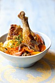 Chicken leg with carrots, onions and potatoes