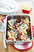 Bake with king prawns, salmon fillets, mussels, asparagus, lemon and chilli