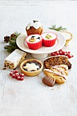 Various different Christmas cakes, mince pies, biscuits and cupcakes