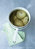 Artichokes in a saucepan