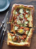 Puff pastry tart with pesto, tomatoes and mozzarella