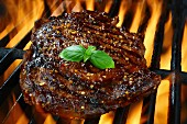 Rib eye steak on a flaming grill
