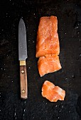 Fresh char fillet with a knife, sliced