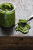 Wild garlic pesto in a jar and on a spoon