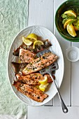 Grilled trout fillets with herbs and lemons