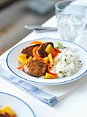 Pork with mango, peppers and rice