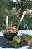 Turkey stuffing with chorizo, corn bread and apple in a bowl on a table outside