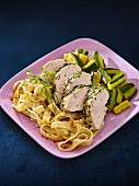 Herb chicken breast with a courgette medley and tagliatelle