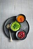 Three dips: pea, pomegranate and chilli