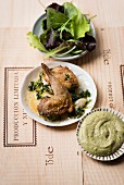Roasted quail with a herb dip and a salad