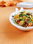 Fried beef with oranges, green beans, carrots and onions on a bed of rice