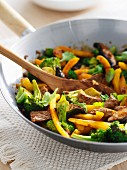 Fried beef with peppers, broccoli and coriander