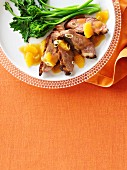 Crispy grilled duck breast with orange sauce and rapini