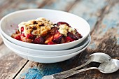 Fruit cobbler with plums, peaches and raspberries