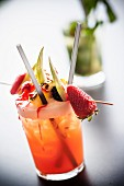 An alcohol-free cocktail with a fruit skewer