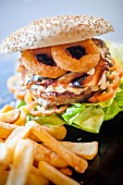 A hamburger with fried squid rings