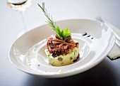 Potato cake with octopus and olives