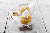 Yellow compote with yoghurt dumplings