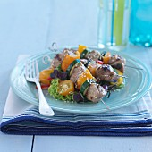 Beef skewers with vegetables and sesame seeds