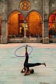 A hula-hoop artiste in the Parque de la Ciutadella in the El Born quarter, Barcelona