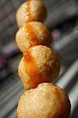 Deep-fried fish balls on a skewer (China) as street food