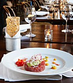 Ahi tuna fish tatar with avocado, chilli, mango sauce and sesame seed lavash