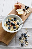 Flax seed oil cream with apples, blueberries and slivered almonds