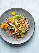 Garden salad with broad beans, radishes, apples and king trumpet mushrooms
