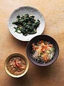 Glass noodle and papaya salad with sautéed spinach and a peanut sauce