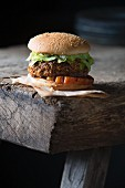 A grilled hamburger on a wooden table