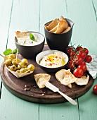 Hummus, tzatziki and stuffed olives