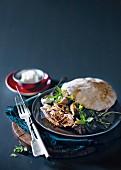 Lamb with feta yoghurt and pita bread