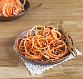Vegetable spaghetti made from sweet potatoes with bourbon and maple syrup and pecan nuts