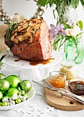 Roast Christmas ham with apple rings