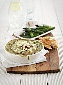 A spinach dip with pepper for asparagus