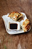 Cong you bing (fried spring onion unleavened bread with a soy dip, China)