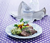 Beef with dill potatoes and a tomato salad