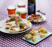 Various open sandwiches with beer