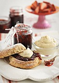 A scone with berry jam