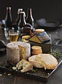 Various types of cheese, crackers and beer