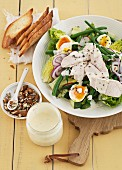 Caesar salad with chicken, runner beans and egg
